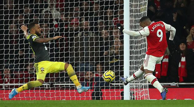 Arsenal's Alexandre Lacazette, right, rescued a point for his side (Yui Mok/PA)