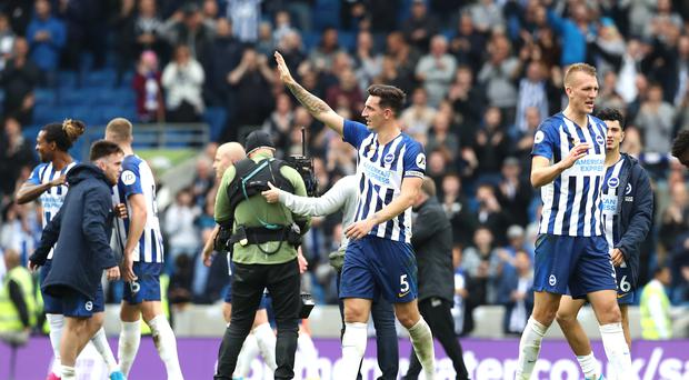 Brighton captain Lewis Dunk will be back after serving a one-match suspension (Gareth Fuller/PA)