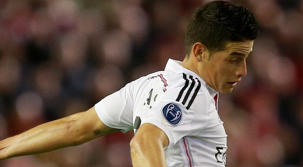 Real Madrid's James Rodriguez, seen here against Liverpool, is reportedly a target for Arsenal (David Davies/PA)