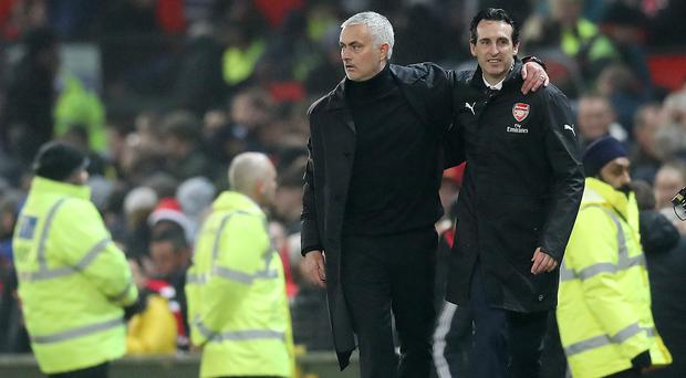 Jose Mourinho (left) went up against Unai Emery during his time at Manchester United (Martin Rickett/PA)