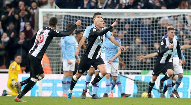 Jonjo Shelvey (centre) celebrates after scoring Newcastle's late equaliser against Manchester City (Owen Humphreys/PA)