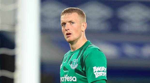 Everton goalkeeper Jordan Pickford wants to be smiling after the derby at Liverpool (PA)