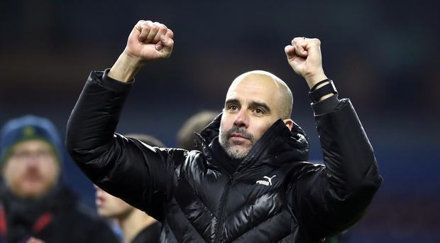 Pep Guardiola was pleased with Manchester City's win at Burnley but is not thinking about the title (Martin Rickett/PA)