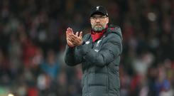 Jurgen Klopp celebrates victory over Everton at Anfield – his 100th Premier League win as manager (Richard Sellers/PA)
