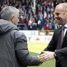 Burnley manager Sean Dyche relishes the challenge of facing the likes of Jose Mourinho (Martin Rickett/PA)