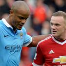 Wayne Rooney, right, and Vincent Kompany played their part in many classic Manchester derbies (Martin Rickett/PA)