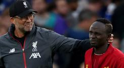 Jurgen Klopp, left, believes Sadio Mane, right, is among the best in the world (Nick Potts/PA)