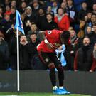 Manchester United midfielder Fred appears to be hit by an object thrown from the crowd (Mike Egerton/PA).