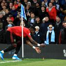 Manchester United midfielder Fred appears to be hit by an object thrown from the crowd (Mike Egerton/PA)