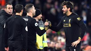 Alisson Becker, right, will miss Liverpool's next two games with Adrian, centre left, in line to deputise (Anthony Devlin/PA)