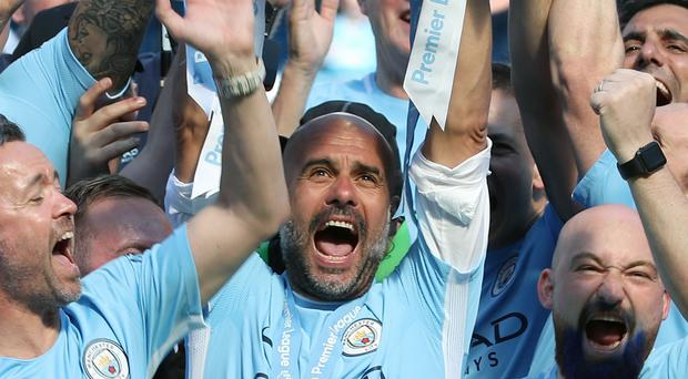 Pep Guardiola has denied there is a break clause in his contract at Manchester City (Martin Rickett/PA)