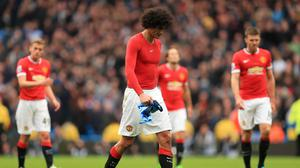 Marouane Fellaini, pictured, was not happy when he felt Sergio Aguero was looking for a penalty at the Etihad Stadium