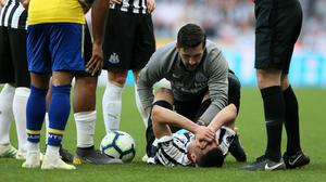 Newcastle's Miguel Almiron receives treatment on the pitch (Richard Sellers/PA)