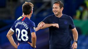 Frank Lampard, right, has warned Chelsea not to relax as the race for Champions League qualification rolls on (Paul Childs/NMC Pool)