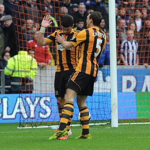 Shane Long, left, was on fine form for Hull against former club West Brom on Saturday