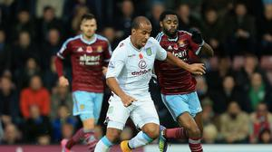 West Ham United's Alex Song,right, and Aston Villa's Gabriel Agbonlahor,left, compete for the ball