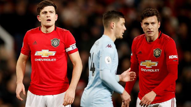 Harry Maguire, left, knows United need to improve (Martin Rickett/PA)