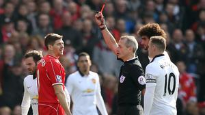Liverpool's Steven Gerrard was shown a red card just 38 seconds after coming on at half-time against Manchester United (Peter Byrne/PA)