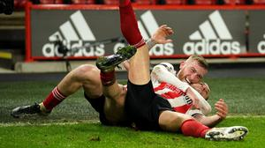 Billy Sharp, right, is tackled by a delighted Oli McBurnie after scoring Sheffield United's winner (Dave Thompson/PA)
