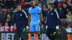 Vincent Kompany, centre, limped off in the closing stages of Manchester City's comfortable 3-0 win