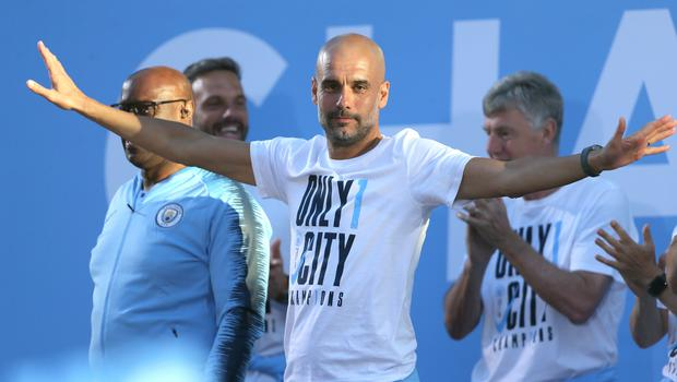 Manchester City manager Pep Guardiola (centre) saw his side collected a record number of Premier League points. (Richard Sellers/PA Images)