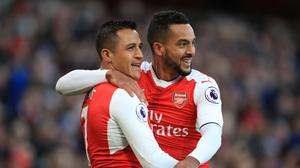 Theo Walcott, pictured right, was delighted to return to the starting line-up