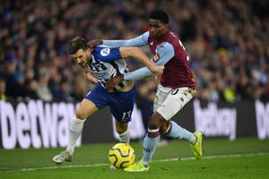 Firm stance: Pascal Gross of Brighton is challenged by Aston Villa ace Kortney Hause. Both clubs are against playing at neutral venues
