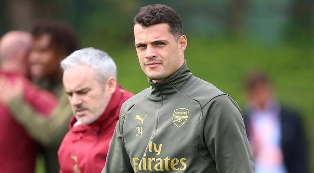 Granit Xhaka remains at the centre of scrutiny over his Arsenal future (Nigel French/PA)