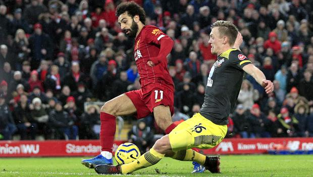 Liverpool's Mohamed Salah scores his side's fourth goal (Peter Byrne, PA)