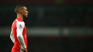 Arsenal's Kieran Gibbs stands dejected after defeat by Manchester United
