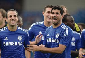 Having a laugh: Chelsea's new recruits Cesc Fabregas and Diego Costa share a joke ahead of the new season