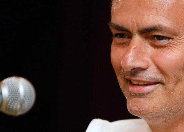 Chelsea's manager Jose Mourinho smiles during a press conference in Kuala Lumpur, Malaysia, Thursday, July 18, 2013. Chelsea will play the Malaysia XI, a Malaysia League selection, on Sunday as part of their Asia tour. (AP Photo/Lai Seng Sin)