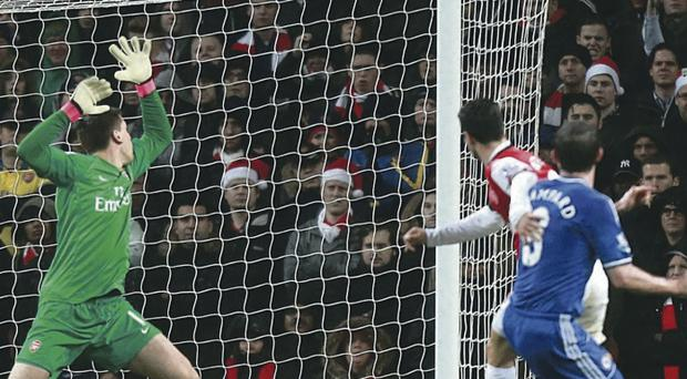 Denied: Frank Lampard sees his effort bounce off Wojciech Szczesny's crossbar, the closest either side came to scoring