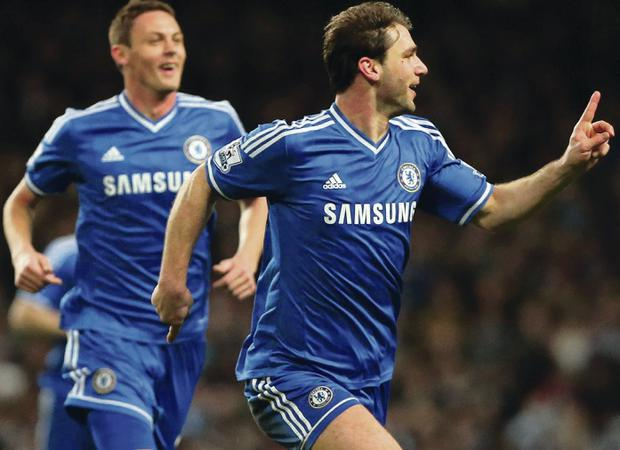Chelsea full-back Branislav Ivanovic races away to celebrate after scoring the winning goal against Manchester City