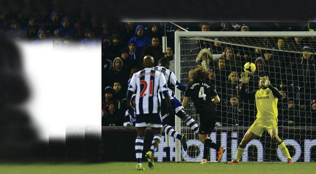 Head boy: Victor Anichebe nods home to earn West Brom a point against Chelsea