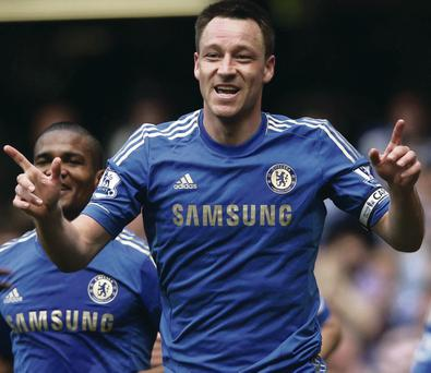 One more year: Chelsea captain John Terry will extend his stay at Stamford Bridge to 20 years after agreeing a new deal