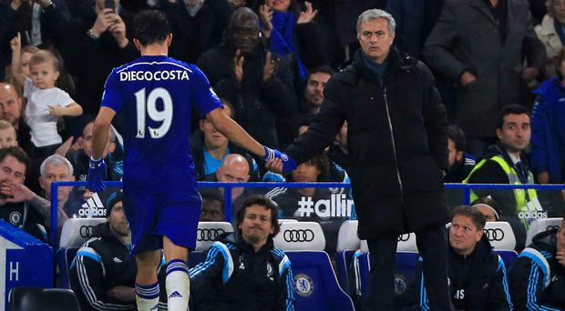 Job well done: Jose Mourinho shakes hands with Diego Costa, who scored