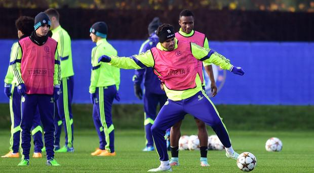 Raring to go: Chelsea's Diego Costa takes possession of the ball during his side's final training session ahead of tonight's tie