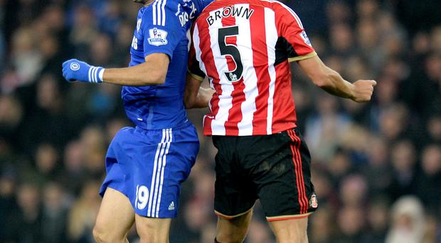 Arms length: Diego Costa catches Wes Brown in the face