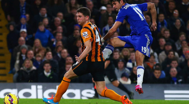 Main man: Diego Costa strikes against Hull to help seal three points for Chelsea