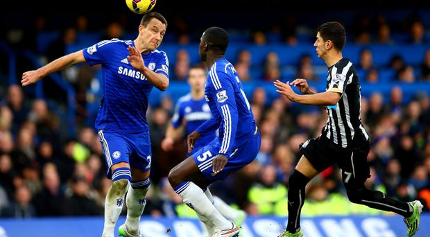 Helping hand: John Terry, in action against Newcastle, has been a big influence on Kurt Zouma (below)