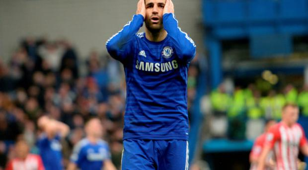 Feeling down: Cesc Fabregas couldn't inspire Chelsea