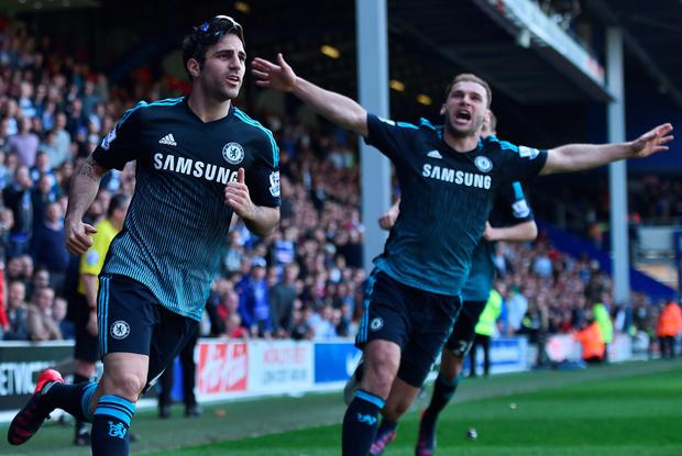 Vital strike: Cesc Fabregas (left) celebrates with Branislav Ivanovic after scoring Chelsea's goal against QPR