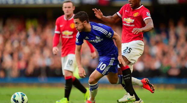 Powering ahead: Wayne Rooney and Antonio Valencia can only watch as Eden Hazard bursts through the United ranks