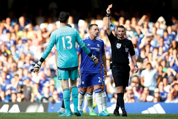 On his way: Thibaut Courtois is sent off after tackling Bafetimbi Gomis