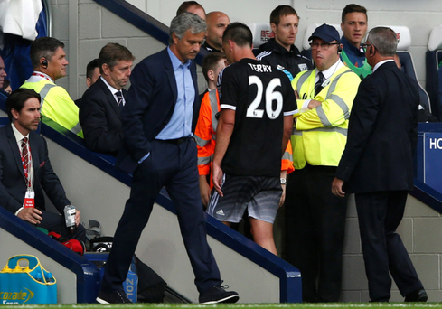 Off you go: Jose Mourinho looks glum after seeing John Terry walk down the tunnel after his dismissal