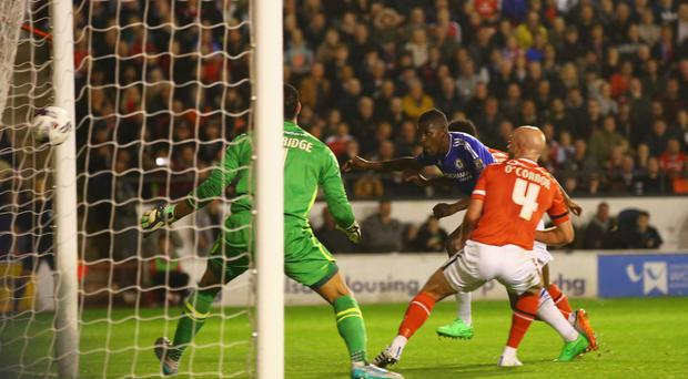 Ram raid: Chelsea ace Ramires beats Neil Etheridge and James O'Connor of Walsall to score their first goal