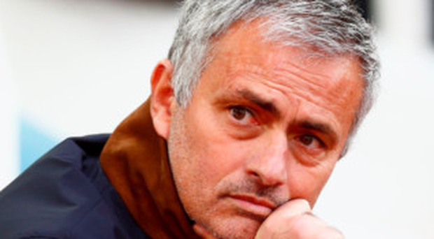 Thinking man: Jose Mourinho has said he would love to return to Inter Milan one day, where he won the treble in 2009-10