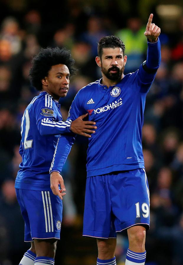 On target: Diego Costa celebrates with Willian after scoring the winner for Chelsea against Norwich