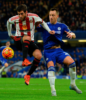 Tight grip: John Terry tussles with Sunderland's Danny Graham